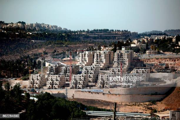 Buildings are seen under construction on October 17 2017 at the Israeli settlement of Ramot situated in a neighbourhood of East Jerusalem annexed by...