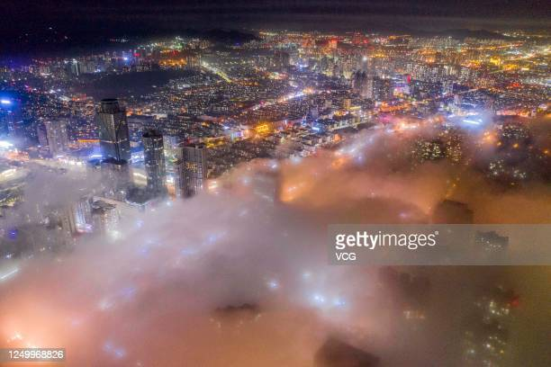 Buildings are shrouded in advection fog at West Coast New Area on June 15 2020 in Qingdao Shandong Province of China