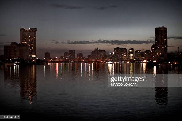 Buildings are silhouetted at dusk along the Nile River which runs through the city of Cairo on January 31 as the nation gears up for strikes and a...