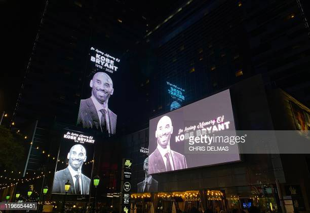 TOPSHOT Buildings around the Staples Center display screens paying tribute to former NBA and Los Angeles Lakers player Kobe Bryant on January 26 2020...