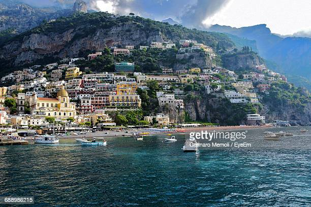 Buildings At Amalfi Coast Against Mountain