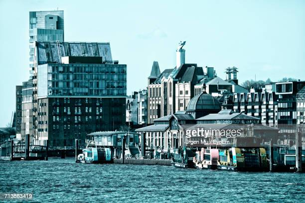 Buildings At Harbor Of Elbe River In City