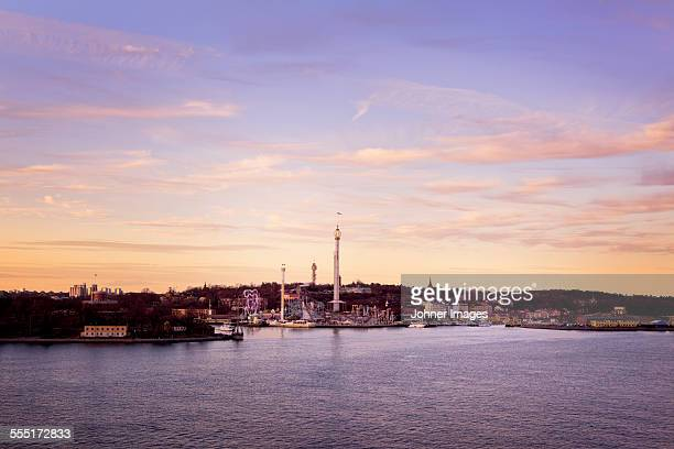 buildings at sea, dusk - djurgarden stock pictures, royalty-free photos & images