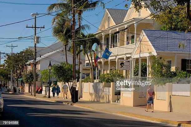 buildings at the roadside, duval street, key west, florida, usa - duval street stock pictures, royalty-free photos & images