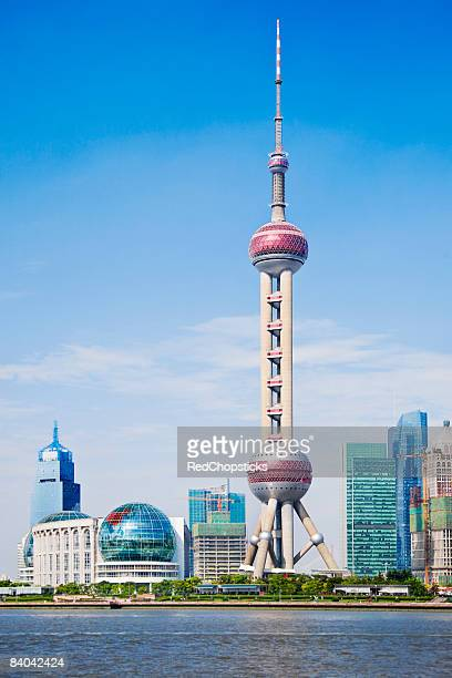 buildings at the waterfront, oriental pearl tower, shanghai, china - oriental pearl tower shanghai stock pictures, royalty-free photos & images