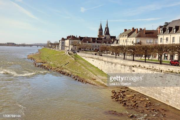 buildings at waterfront - loir et cher stock pictures, royalty-free photos & images