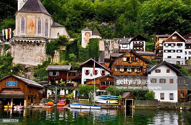 buildings beside river - hallstatt stock pictures, royalty-free photos & images