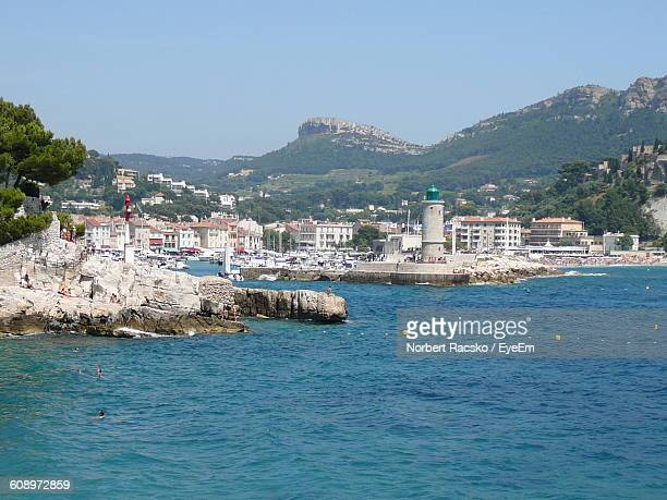 buildings by blue sea against sky - cassis stock pictures, royalty-free photos & images