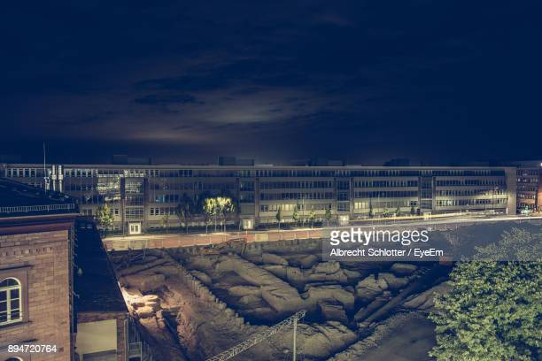 buildings by construction site against sky - albrecht schlotter stock photos and pictures