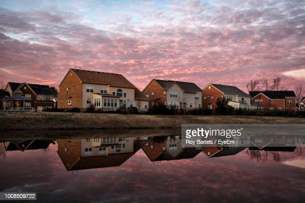 buildings by lake against sky during sunset - princess anne princess royal photos stock pictures, royalty-free photos & images