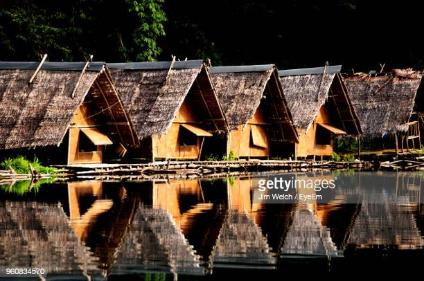 buildings by lake against sky - kao sok national park stock pictures, royalty-free photos & images