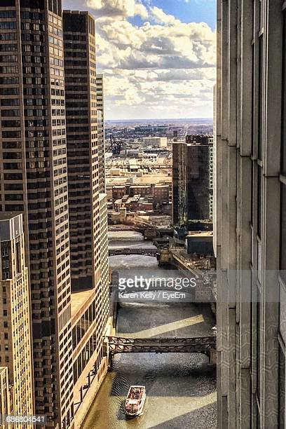 Buildings By Randolph Street Bridge Over Chicago River Against Cloudy Sky