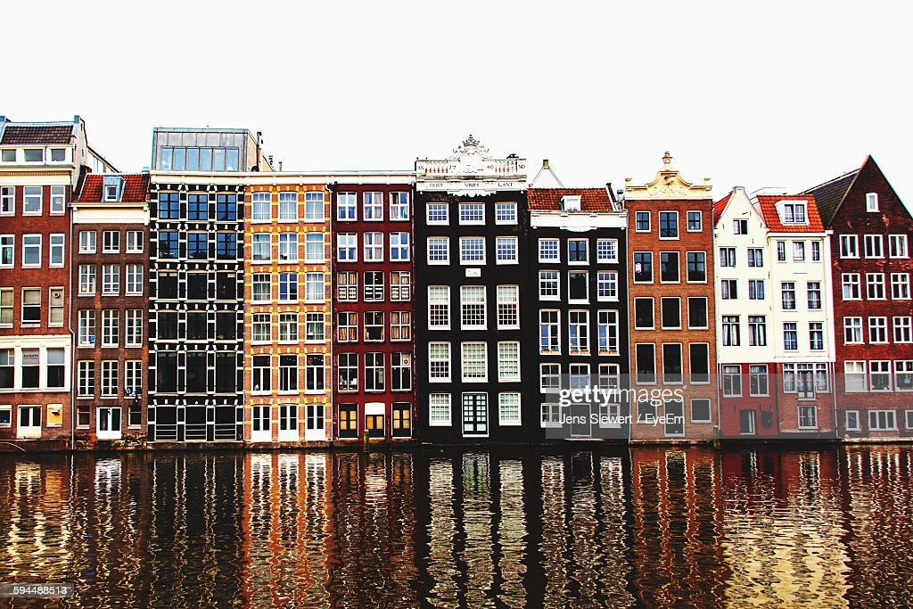Buildings By River Against Clear Sky : Stock-Foto