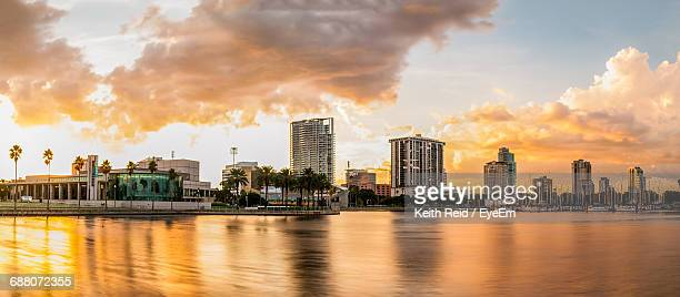 buildings by river - st. petersburg florida stock photos and pictures
