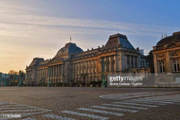 buildings by road against sky - laeken stock pictures, royalty-free photos & images