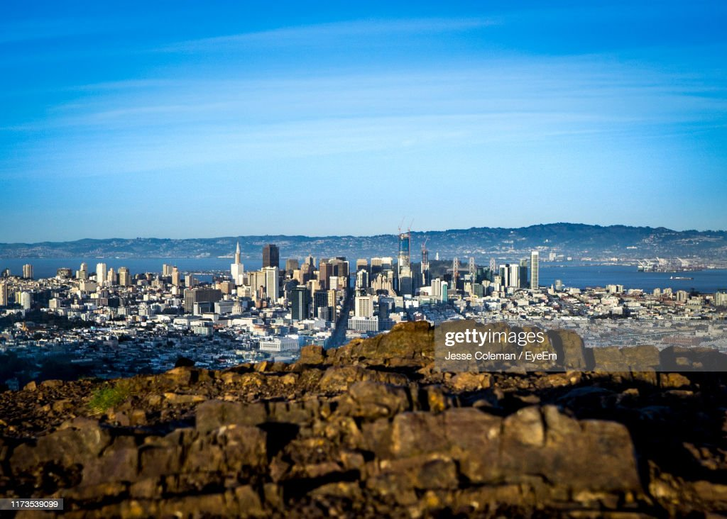 Buildings By Sea Against Blue Sky : Stock Photo
