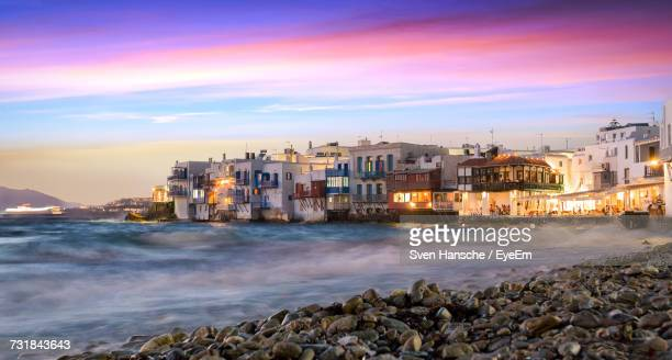 Buildings By Sea Against Sky During Sunset At Mykonos