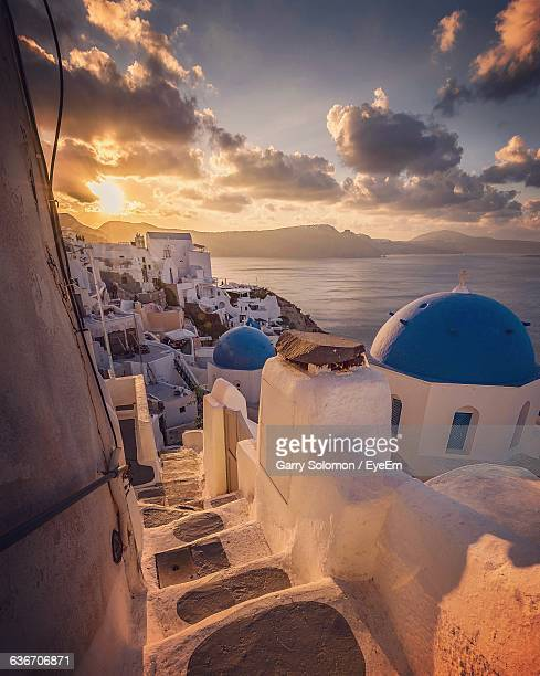 Buildings By Sea Against Sky During Sunset At Santorini