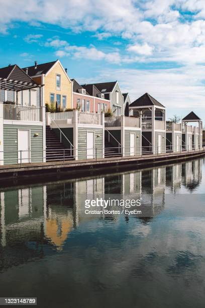 buildings by swimming pool against sky - bortes stock pictures, royalty-free photos & images