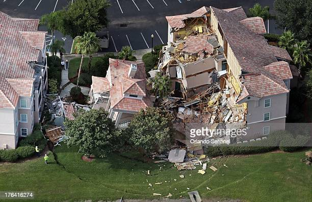 Buildings collapse into a sinkhole at the Summer Bay Resort on US Highway 192 in Clermont Florida Monday August 12 2013 Guests had only 10 to 15...