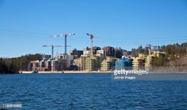 buildings cranes on coast - nova scotia duck tolling retriever stock pictures, royalty-free photos & images