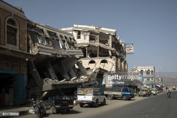 Buildings damaged by airstrikes on the main street in Saada the main Houthi stronghold in Yemen