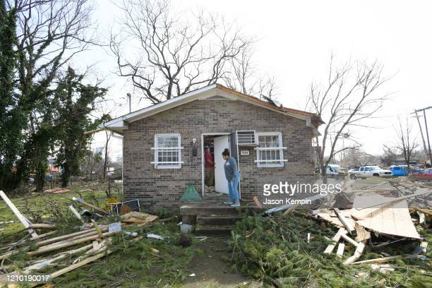 Buildings damaged by the storm are seen in the North Nashville neighborhood following devastating tornadoes on March 03 2020 in Nashville Tennessee...