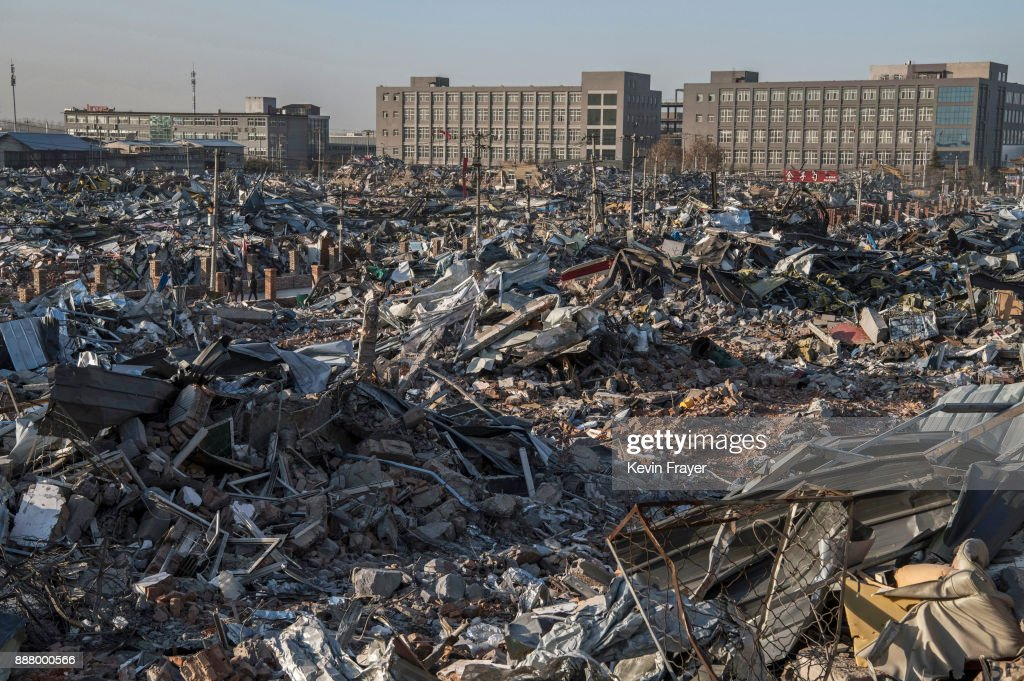 Buildings demolished by authorities are seen in an area that used to have migrant housing and factories on December 6, 2017 in the Daxing District of Beijing, China.Thousands of migrant workers have been forcibly evicted in recent weeks in a sweeping government safety campaign following a deadly fire at a housing settlement. Many migrants, who came to Beijing from poor rural areas to find employment, say they were given little notice to leave and cannot afford to move somewhere else. The government's plan to demolish the buildings was actually announced in a 2015 strategy to reduce and cap the capital's population, but the mass evictions were accelerated after the fire and have stirred public backlash. The migrant population typically work in jobs such as construction, sanitation, and deliveries that have effectively built Beijing and keep it running. Some companies announced assistance and temporary housing for employees who have been affected, but many migrants say they have little choice but to move back to their hometowns.