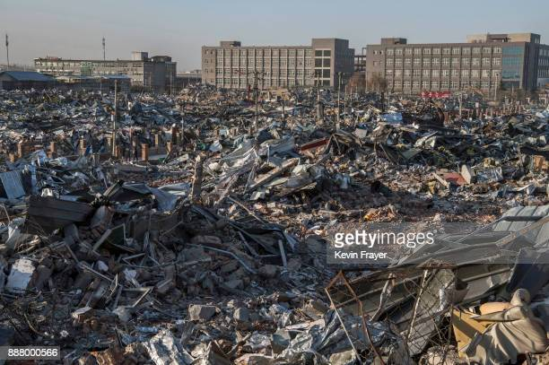 Buildings demolished by authorities are seen in an area that used to have migrant housing and factories on December 6 2017 in the Daxing District of...