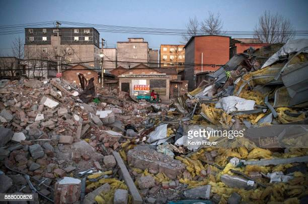 Buildings demolished by authorities are seen in an area with former migrant housing on December 5 2017 in the Changing District in Beijing China...