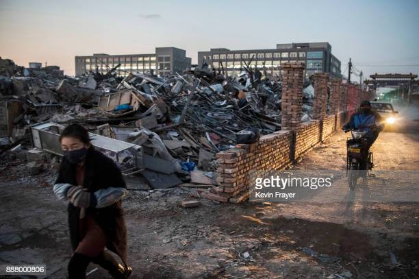 Buildings demolished by authorities in an area that used to have migrant housing and factories on December 6 2017 are seen in the Daxing District of...