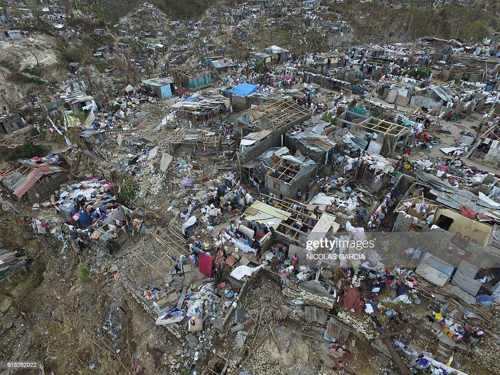 Buildings destroyed and damaged by Hurricane Matthew are seen in Jeremie, in western Haiti, on October 7, 2016. The full scale of the devastation in hurricane-hit rural Haiti became clear as the death toll surged over 400, three days after Hurricane Matthew leveled huge swaths of the country's south. / AFP / Nicolas GARCIA