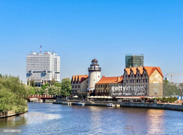 buildings in city against blue sky - kaliningrad stock pictures, royalty-free photos & images