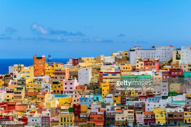 buildings in city against blue sky - las palmas de gran canaria stock pictures, royalty-free photos & images