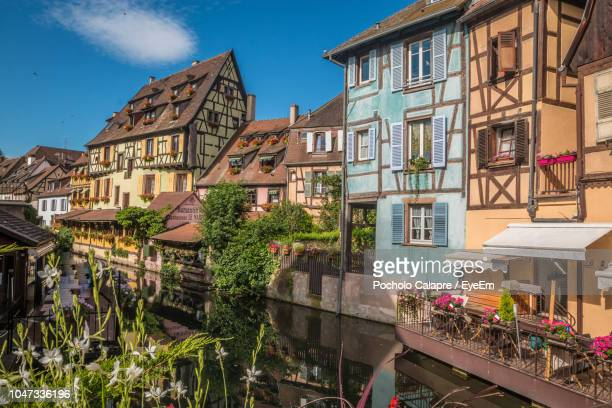 buildings in city against blue sky - strasbourg stock pictures, royalty-free photos & images