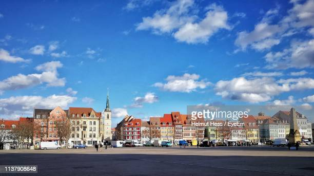 buildings in city against blue sky - erfurt stock pictures, royalty-free photos & images