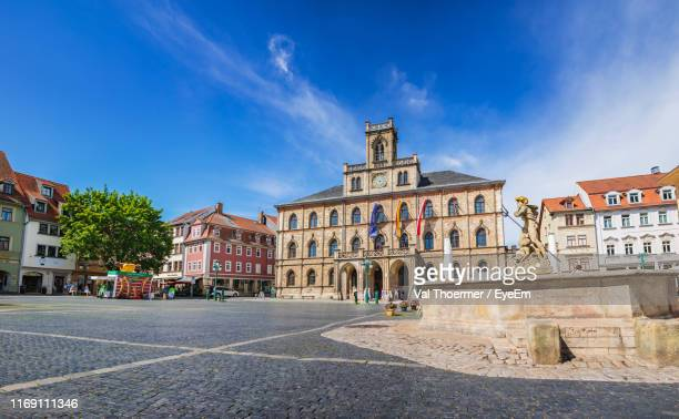 buildings in city against blue sky - thuringia stock pictures, royalty-free photos & images