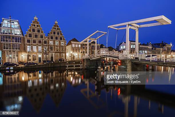 buildings in city against blue sky - haarlem stock photos and pictures