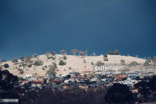buildings in city against clear blue sky - canberra stock pictures, royalty-free photos & images
