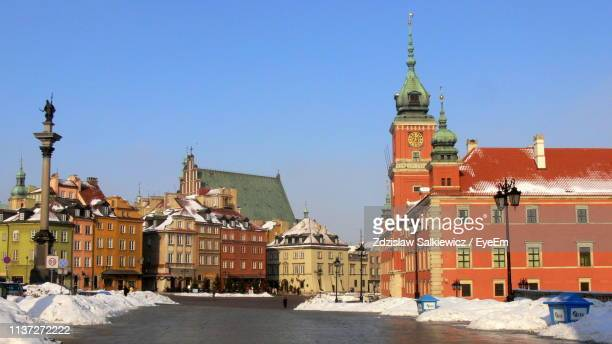 buildings in city against clear blue sky - warsaw stock pictures, royalty-free photos & images