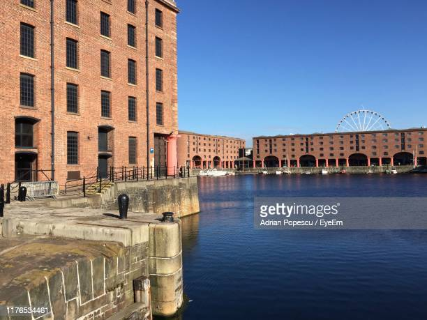 buildings in city against clear blue sky - waterfront stock pictures, royalty-free photos & images