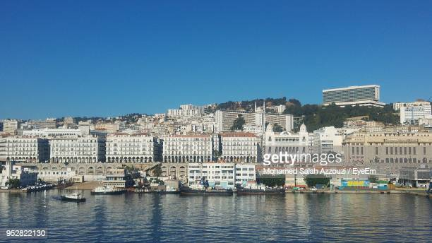 buildings in city against clear blue sky - algiers algeria stock pictures, royalty-free photos & images