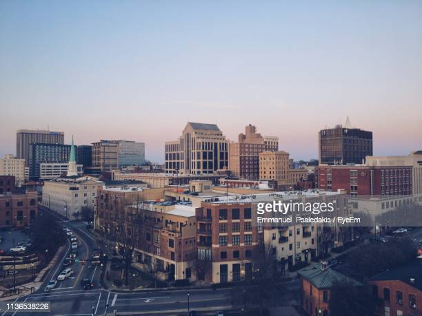 buildings in city against clear sky during sunset - greenville south carolina stock photos and pictures