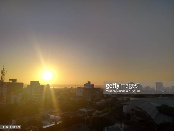 buildings in city against clear sky during sunset - barranquilla stock pictures, royalty-free photos & images