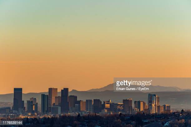 buildings in city against clear sky during sunset - denver stock pictures, royalty-free photos & images