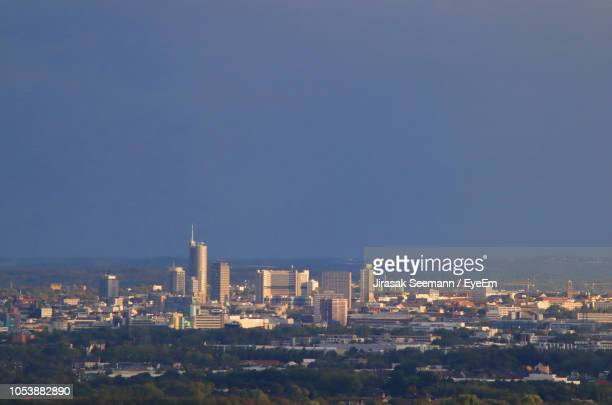 buildings in city against clear sky - essen germany stock pictures, royalty-free photos & images