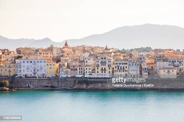 buildings in city against clear sky - corfu stock pictures, royalty-free photos & images