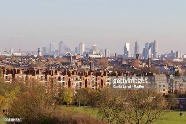 buildings in city against clear sky - hampstead heath stock pictures, royalty-free photos & images