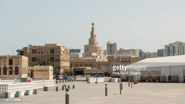 buildings in city against clear sky - doha stock pictures, royalty-free photos & images