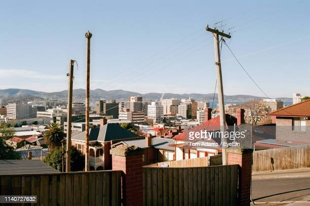 buildings in city against clear sky - hobart tasmania stock pictures, royalty-free photos & images